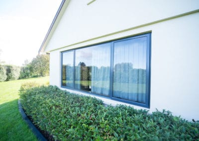 Aluminium awning and fixed windows - retrofitted with double glazing