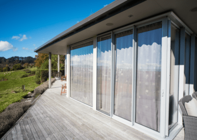 Full height aluminium windows and doors retrofitted with double glazing