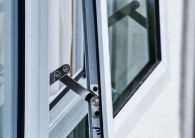 Close-up of aluminium awning and fixed windows - retrofitted with double glazing (including securitity stays)